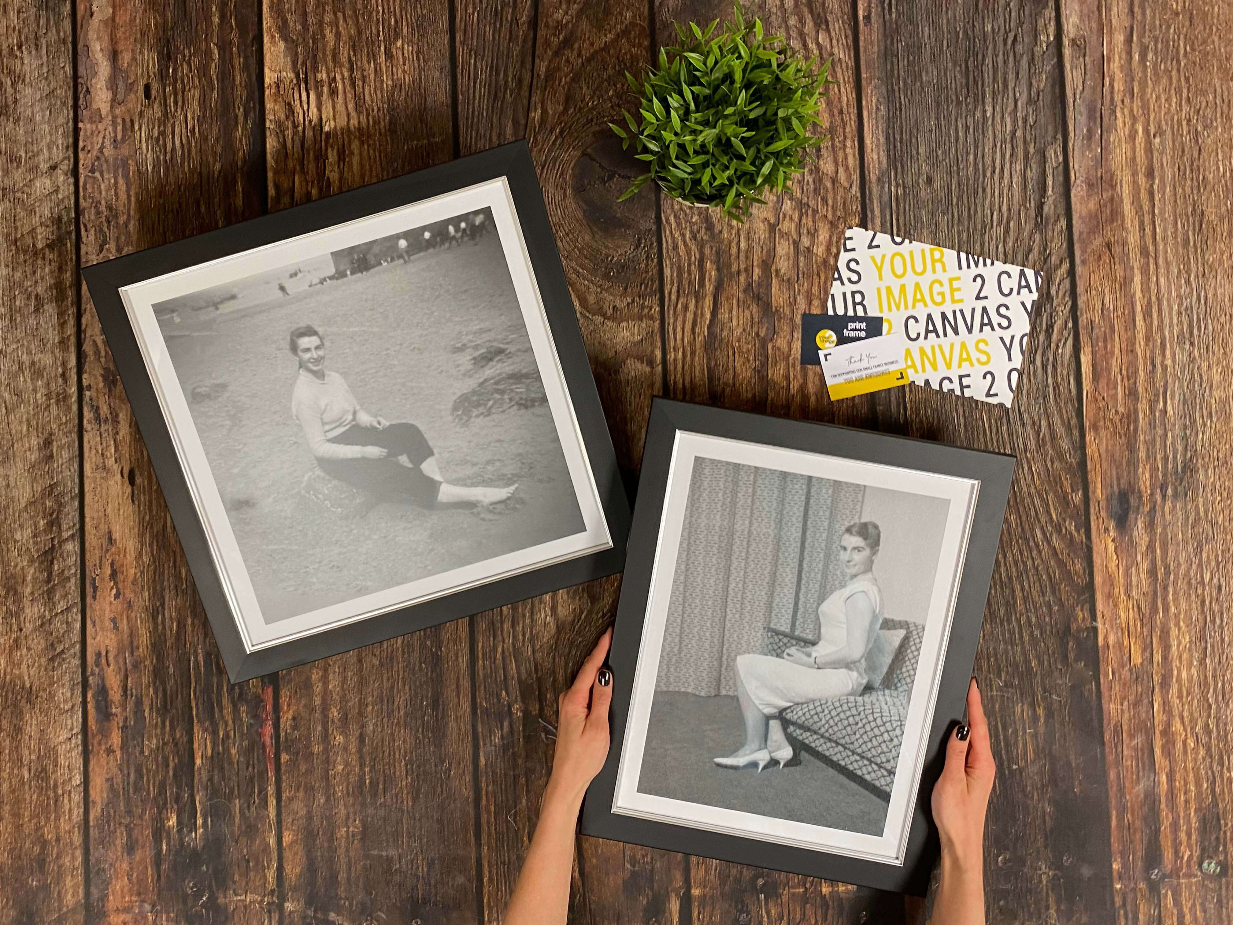 Two beautiful black framed canvas prints of restored old photographs for an affordable price